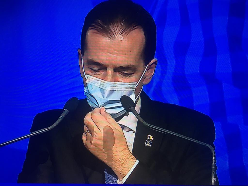 Ludovic Orban duce mina la masca si o ridica pe nas