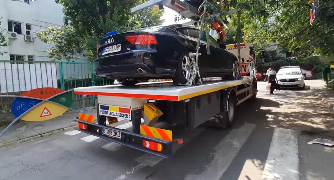 O mașină parcată zile-n șir pe o trecere de pietoni din S4 a fost ridicată. Cât costă recuperarea și cât durează